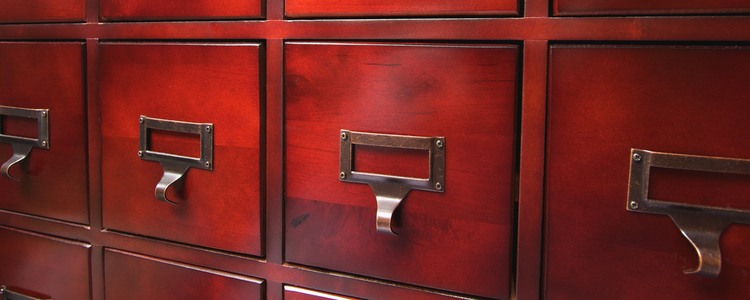 Lustrous Wooden Card File Cabinet in Dramatic LIght